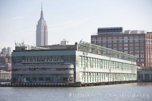 Pier 57.  Manhattan waterline.  Pier 57 is a long pier built on floating concrete caissons in the Hudson River in Manhattan, New York City. Built in 1952, it is located near the end of 15th Street on the West Side Highway, just south of the Chelsea Piers sports complex