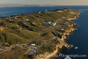 Point Loma peninsula, with scalloped sandstone cliffs edging the Pacific Ocean, looking south.   Navy facilities are scattered along this section of Point Loma, San Diego, California