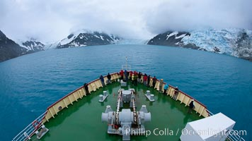 M/V Polar Star approaches Jenkins Glacier (left), Risting Glacier (center) and a third glacier (right) at the end of Drygalski Fjord