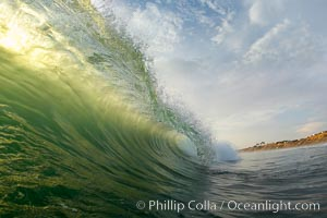 A green wave breaking, with sunset light filtering through, Ponto, Carlsbad, California