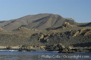 Rugged, volcanic coastline of San Clemente Island at Pyramid Cove, near the islands southeastern tip.  San Clemente Island is used as a US Navy bombing target