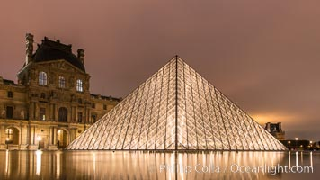 The Louvre Pyramid, Pyramide du Louvre,  large glass and metal pyramid in the main courtyard (Cour Napoleon) of the Louvre Palace (Palais du Louvre) in Paris. Musee du Louvre, Paris, France, natural history stock photograph, photo id 28093