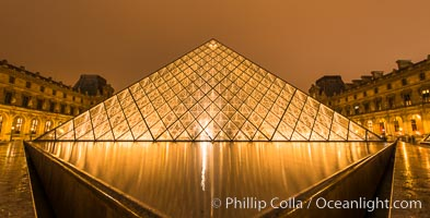The Louvre Pyramid, Pyramide du Louvre,  large glass and metal pyramid in the main courtyard (Cour Napoleon) of the Louvre Palace (Palais du Louvre) in Paris, Musee du Louvre