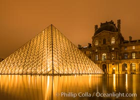 The Louvre Pyramid at Night, Pyramide du Louvre,  large glass and metal pyramid in the main courtyard (Cour Napoleon) of the Louvre Palace (Palais du Louvre) in Paris. Musee du Louvre, Paris, France, natural history stock photograph, photo id 28095