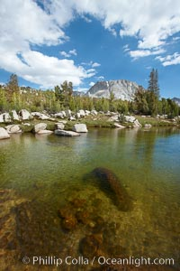 Rafferty Creek, flows under blue skies, on approach to Vogelsang High Sierra Camp.  Vogelsang Peak is seen in the distance, Yosemite National Park, California