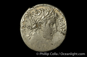 Roman emperor Augustus (27 B.C.-14 A.D.), depicted on ancient Roman coin (silver, denom/type: Tetradrachm) (Ar. Tetradrachm. Syria; Antioch and Orentum. Obverse: Lauriate bust right. Reverse: City godess seated on rock, holding palm branch. River god swimming at her feet.  N=year 54 = AD 5/6. S107 var.)