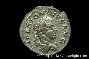Roman emperor Elegabalus (218-222 A.D.), depicted on ancient Roman coin (silver, denom/type: Denarius) (Denarius, EF, Sea 2003. Obverse: IMP ANTONINVS PIVA AVG. Reverse: Liberty standing left.)