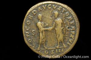 Roman emperor Marcus Aurelius (161-180 A.D.), depicted on ancient Roman coin (bronze, denom/type: Sestertius) (AE Sestertius. Obverse: IMP C, AES M AVREL ANTONINVS AVG PM. Reverse: CONCORD AVGVSTOR TR P XVI COS III SC.)