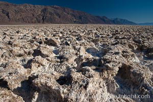 Devils Golf Course, California.  Evaporated salt has formed into gnarled, complex crystalline shapes in on the salt pan of Death Valley National Park, one of the largest salt pans in the world.  The shapes are constantly evolving as occasional floods submerge the salt concretions before receding and depositing more salt.,  Copyright Phillip Colla, image #15613, all rights reserved worldwide.