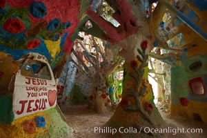 "Salvation Mountain, near the desert community of Slab City and the small town of Niland on the east side of the Salton Sea.  Built over several decades by full-time resident Leonard Knight, who lives at the site, Salvation Mountain was built from over 100,000 gallons of paint, haybales, wood and metal and was created by Mr. Knight to convey the message that ""God Loves Everyone"""