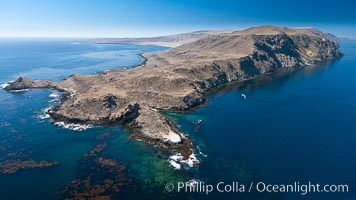 San Clemente Island Pyramid Head, the distinctive pyramid shaped southern end of the island.  San Clemente Island Pyramid Head, showing geologic terracing, underwater reefs and giant kelp forests