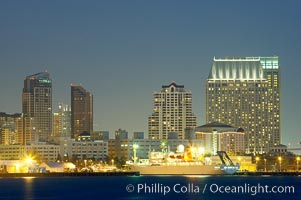 San Diego city skyline and cruise ship terminal at dusk, viewed from Harbor Island
