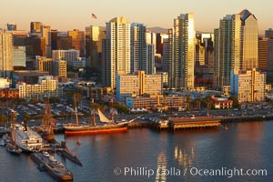San Diego waterfront and skyline, Star of India (lower left), high rise modern office buildings, San Diego Bay, sunset