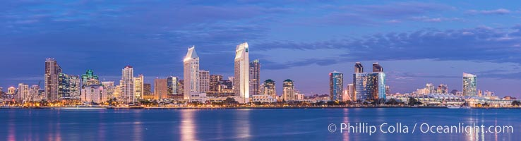 Full moon rising over San Diego city skyline, sunset, storm clouds, viewed from Coronado Island