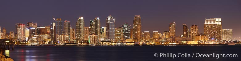 San Diego city skyline at sunset, showing the buildings of downtown San Diego rising above San Diego Harbor, viewed from Harbor Island.  A panoramic photograph, composite of four separate images