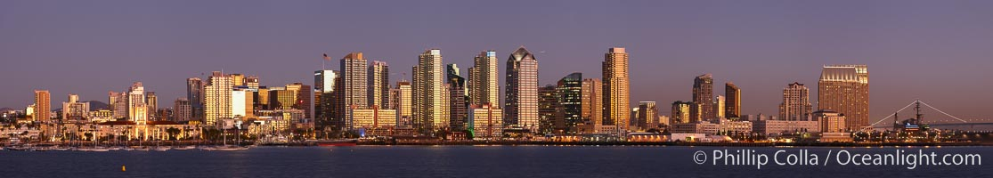San Diego city skyline at sunset, showing the buildings of downtown San Diego rising above San Diego Harbor, viewed from Harbor Island.  A panoramic photograph, composite of six separate images
