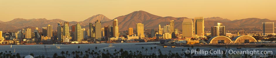 San Diego city skyline, showing the buildings of downtown San Diego rising above San Diego Harbor, viewed from Point Loma at sunset, with mountains of the Cleveland National Forest rising in the distance.  A panoramic photograph, composite of six separate images. San Diego, California, USA, natural history stock photograph, photo id 22252