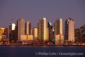 San Diego city skyline at sunset, showing the buildings of downtown San Diego rising above San Diego Harbor, viewed from Harbor Island