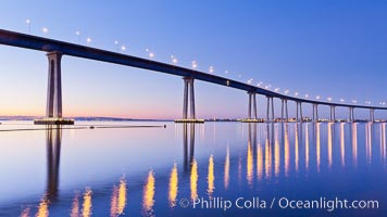 San Diego Coronado Bridge, linking San Diego to the island community of Coronado, spans San Diego Bay.  Dawn, lavender sky