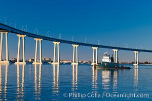 San Diego Coronado Bridge, linking San Diego to the island community of Coronado, spans San Diego Bay.  Dawn