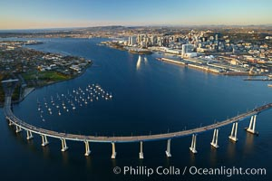 San Diego Coronado Bridge, known locally as the Coronado Bridge, links San Diego with Coronado, California.  The bridge was completed in 1969 and was a toll bridge until 2002.  It is 2.1 miles long and reaches a height of 200 feet above San Diego Bay.  Coronado Island is to the left, and downtown San Diego is to the right in this view looking north