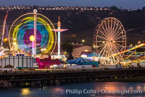 San Diego County Fair at night.  Del Mar Fair at dusk, San Dieguito Lagoon in foreground. Del Mar, California, USA, natural history stock photograph, photo id 31026
