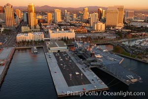 San Diego downtown waterfront, with USS Midway aircraft carrier and Navy museum (right), sunset