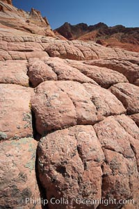 Sandstone joints.  These cracks and joints are formed in the sandstone by water that seeps into spaces and is then frozen at night, expanding and cracking the sandstone into geometric forms, North Coyote Buttes, Paria Canyon-Vermilion Cliffs Wilderness, Arizona