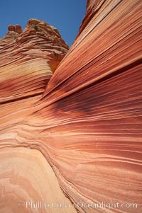 Sandstone striations.  Prehistoric sand dunes, compressed into sandstone, are now revealed in sandstone layers subject to the carving erosive forces of wind and water, North Coyote Buttes, Paria Canyon-Vermilion Cliffs Wilderness, Arizona