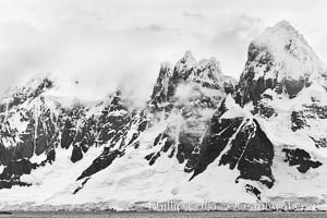Scenery in Antarctica.  Clouds, ocean and glaciers, near Port Lockroy