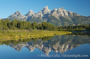 The Teton Range is reflected in the glassy waters of the Snake River at Schwabacher Landing.,  Copyright Phillip Colla, image #12982, all rights reserved worldwide.