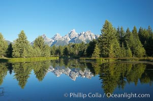 The Teton Range is reflected in the glassy waters of the Snake River at Schwabacher Landing. Schwabacher Landing, Grand Teton National Park, Wyoming, USA