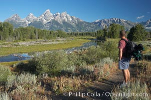 A hiker admires the Teton Range, Schwabacher Landing, Grand Teton National Park, Wyoming