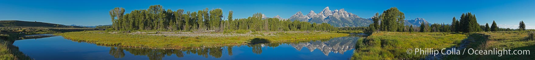 Panorama of the Teton Range reflected in the still waters of Schwabacher Landing, a sidewater of the Snake River.,  Copyright Phillip Colla, image #19129, all rights reserved worldwide.