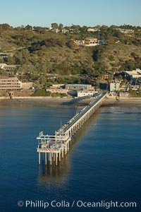 SIO Pier.  The Scripps Institution of Oceanography research pier is 1090 feet long and was built of reinforced concrete in 1988, replacing the original wooden pier built in 1915. The Scripps Pier is home to a variety of sensing equipment above and below water that collects various oceanographic data. The Scripps research diving facility is located at the foot of the pier. Fresh seawater is pumped from the pier to the many tanks and facilities of SIO, including the Birch Aquarium. The Scripps Pier is named in honor of Ellen Browning Scripps, the most significant donor and benefactor of the Institution. Scripps Institution of Oceanography, La Jolla, California, USA, natural history stock photograph, photo id 22286