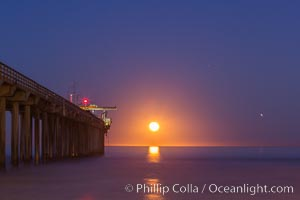 Full moon sets over the Pacific Ocean, Scripps Research Pier, La Jolla