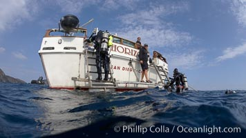SCUBA divers climb aboard boat Horizon, after a morning dive along the shores of Catalina Island. Catalina Island, California, USA, natural history stock photograph, photo id 23570