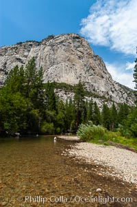 North Dome towers above the South Fork of the Kings River as it flows through Kings Canyon National Park, in the southeastern Sierra mountain range. Late summer, Sequoia Kings Canyon National Park, California