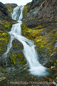 Shackleton Falls, named for explorer Sir Ernest Shackleton, formed from glacial meltwaters, near Stromness Bay, Stromness Harbour