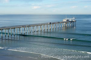 The Scripps Institution of Oceanography research pier is 1090 feet long and was built of reinforced concrete in 1988, replacing the original wooden pier built in 1915.  The Scripps Pier is home to a variety of sensing equipment above and below water that collects various oceanographic data.  The Scripps research diving facility is located at the foot of the pier.  Fresh seawater is pumped from the pier to the many tanks and facilities of SIO, including the Birch Aquarium.  The Scripps Pier is named in honor of Ellen Browning Scripps, the most significant donor and benefactor of the Institution, La Jolla, California