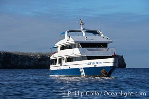 Sky Dancer, a liveaboard dive tour boat, at anchor. Wolf Island, Galapagos Islands, Ecuador, natural history stock photograph, photo id 16697