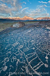 Sky Rock petroglyphs near Bishop, California.  Hidden atop on of the enormous boulders of the Volcanic Tablelands lies Sky Rock, a set of petroglyphs that face the sky.  These superb examples of native American petroglyph artwork are thought to be Paiute in origin, but little is known about them. Bishop, California, USA