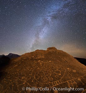 The Milky Way at Night over Sky Rock.  Sky Rock petroglyphs near Bishop, California. Hidden atop an enormous boulder in the Volcanic Tablelands lies Sky Rock, a set of petroglyphs that face the sky. These superb examples of native American petroglyph artwork are thought to be Paiute in origin, but little is known about them. Bishop, California, USA, natural history stock photograph, photo id 28809