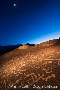 Sky Rock at night, light by moonlight with stars in the clear night sky above.  Sky Rock petroglyphs near Bishop, California. Hidden atop an enormous boulder in the Volcanic Tablelands lies Sky Rock, a set of petroglyphs that face the sky. These superb examples of native American petroglyph artwork are thought to be Paiute in origin, but little is known about them., natural history stock photograph, photo id 28501