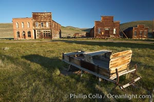 Sleigh, with Main Street buildings Dechambeau Hotel and I.O.O.F. Hall (left), Miners Union Hall and town morgue (right), Bodie State Historical Park, California