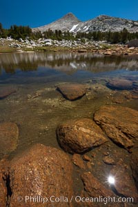 Small alpine lake, with Peak 11,100' rising above, late summer in the high Sierra Nevada near Vogelsang and Lake Evelyn, Yosemite National Park, California