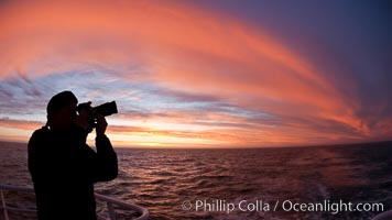 Photographer takes picture of a spectacular sunset arch, spanning the heavens from horizon to horizon, over the open sea between the Falkland Islands and South Georgia Island. Southern Ocean, natural history stock photograph, photo id 24096
