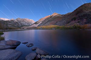 Star trails and alpenglow on the Sierra Nevada, Paiute Peak, before sunrise, reflected in North Lake in the Sierra Nevada. Bishop Creek Canyon Sierra Nevada Mountains, Bishop, California, USA, natural history stock photograph, photo id 26053