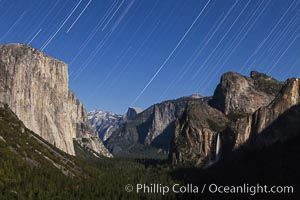 Star trails over Yosemite Valley, viewed from Tunnel View, the floor of Yosemite Valley illuminated by a full moon.  El Capitan on left, Bridalveil Falls on right, Half Dome in distant center, Yosemite National Park, California