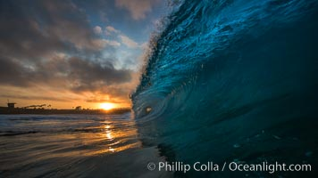 Sunrise breaking wave, dawn surf